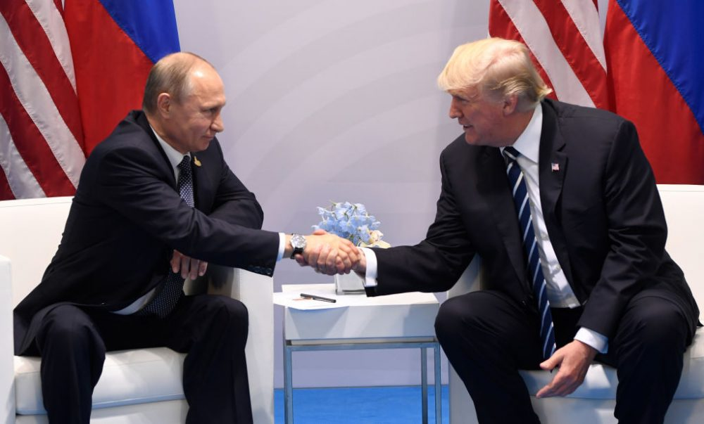 U.S. President Donald Trump and Russia's President Vladimir Putin shake hands during a meeting on the sidelines of the G-20 Summit in Hamburg, Germany, on July 7, 2017. (Saul Loeb/AFP/Getty Images)