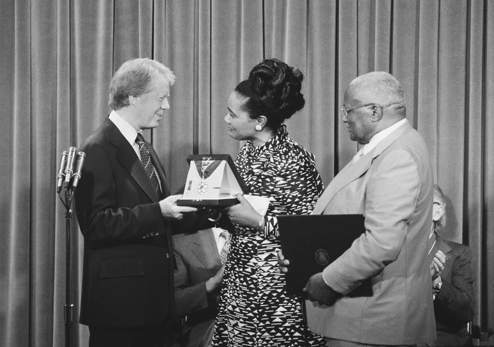 President Jimmy Carter, left, presents the Medal of Freedom Award to Coretta Scott King during a ceremony at the White House on July 11, 1977. (AP)