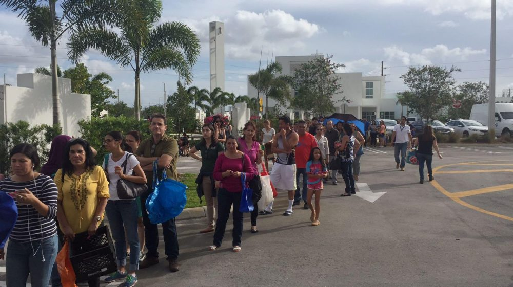 Recently arrived Venezuelan immigrants lining up at Our Lady of Guadalupe church in Doral for food and assistance. (Franklin Gutierrez/St. Vincent de Paul)
