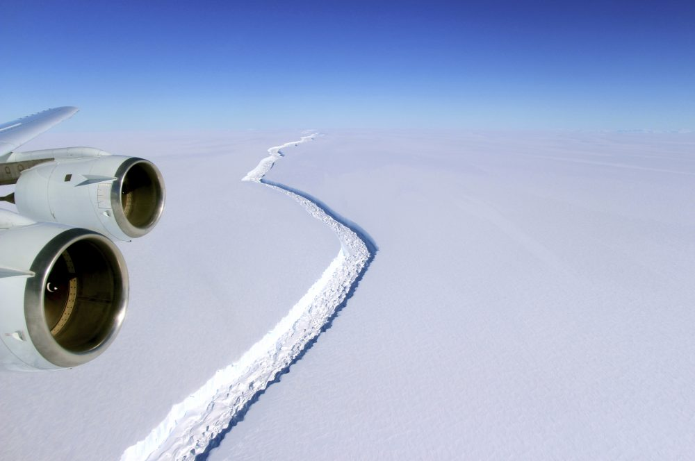 This Nov. 10, 2016 aerial photo released by NASA, shows a rift in the Antarctic Peninsula's Larsen C ice shelf. A vast iceberg with twice the volume of Lake Erie has broken off from a key floating ice shelf in Antarctica, scientists said Wednesday July 12, 2017 . The iceberg broke off from the Larsen C ice shelf, scientists at the University of Swansea in Britain said. The iceberg, which is likely to be named A68, is described as weighing 1 trillion tons (1.12 trillion U.S. tons). (John Sonntag/NASA via AP)