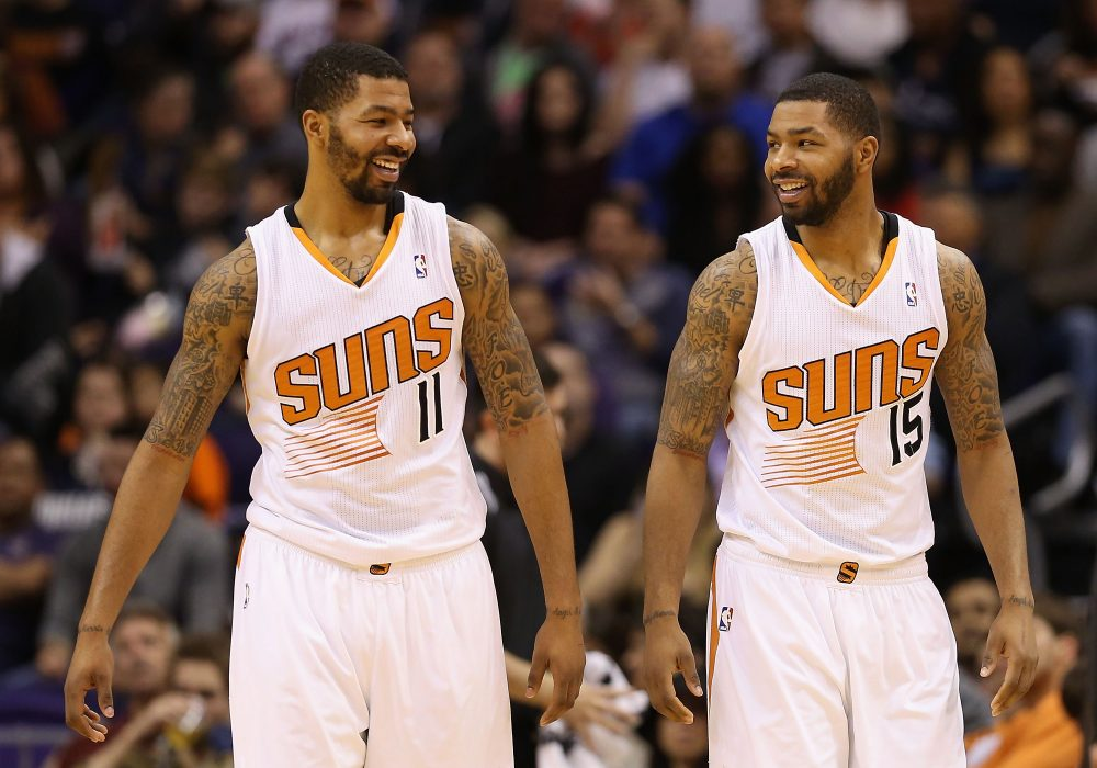 Markieff Morris #11 and Marcus Morris #15 are just one set of identical twins in pro sports. (Christian Petersen/Getty Images)