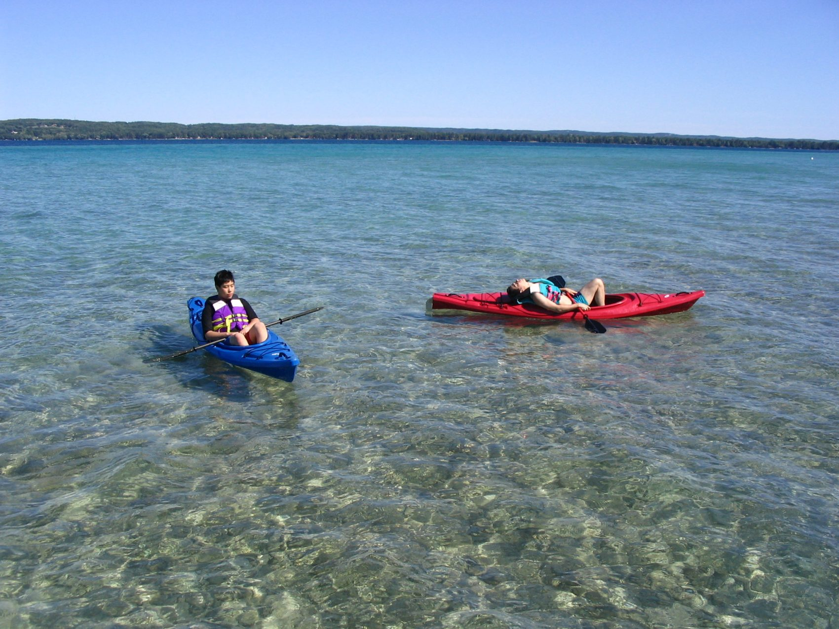 Kayakers on Torch Lake in Michigan. (Andrew Lin via Wikimedia)