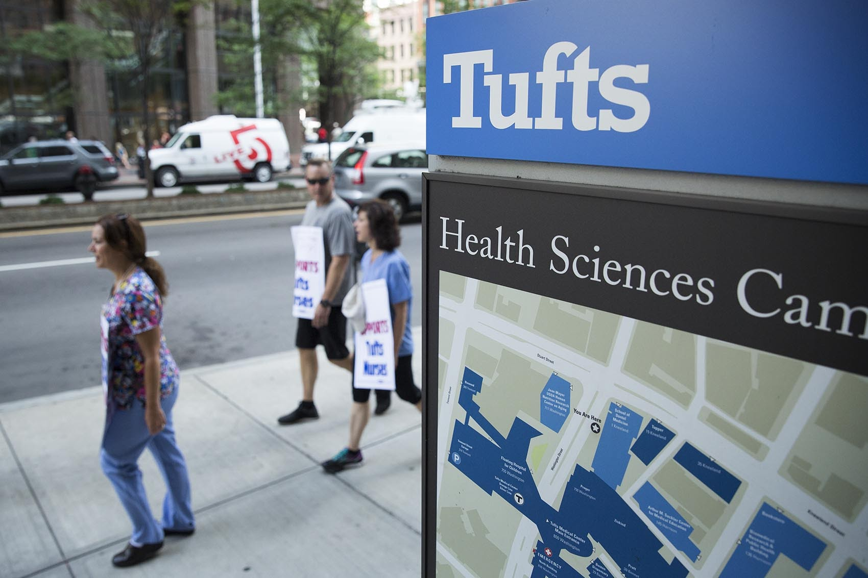 Supporters of Tufts Medical Center's striking nurses, in July 2017. (Robin Lubbock/WBUR/File)