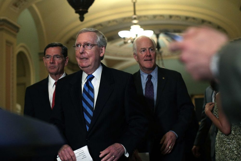 U.S. Senate Majority Leader Sen. Mitch McConnell (R-Ky.) (center), Sen. John Barrasso (R-Wyo.) (left), and Senate Majority Whip Sen. John Cornyn (R-Texas) approach the podium for a news briefing after the weekly Senate Republican Policy Luncheon July 11, 2017 at the Capitol in Washington. (Alex Wong/Getty Images)