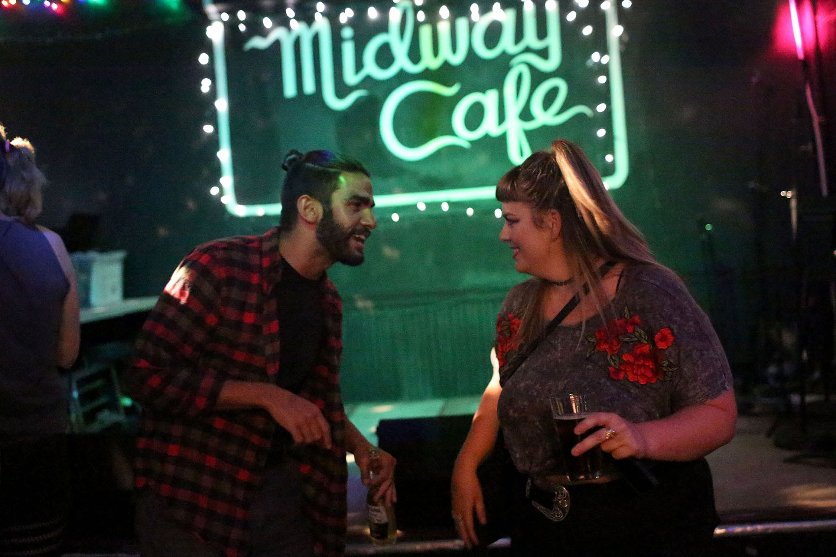 Kristie Macewen and Anthony Fusco dance at Midway Cafe. (Hadley Green for WBUR)