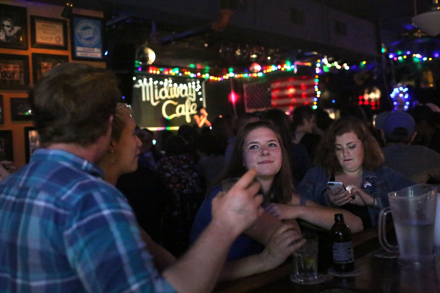 People sit at the Midway Cafe's bar. (Hadley Green for WBUR)