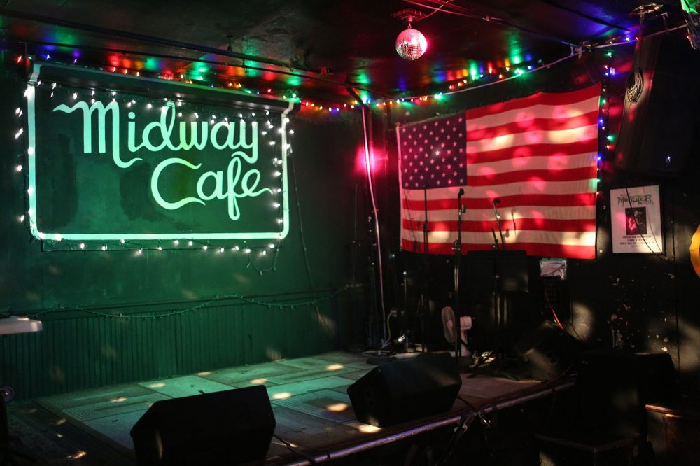 The stage at the Midway Cafe in Boston's Jamaica Plain. (Hadley Green for WBUR)