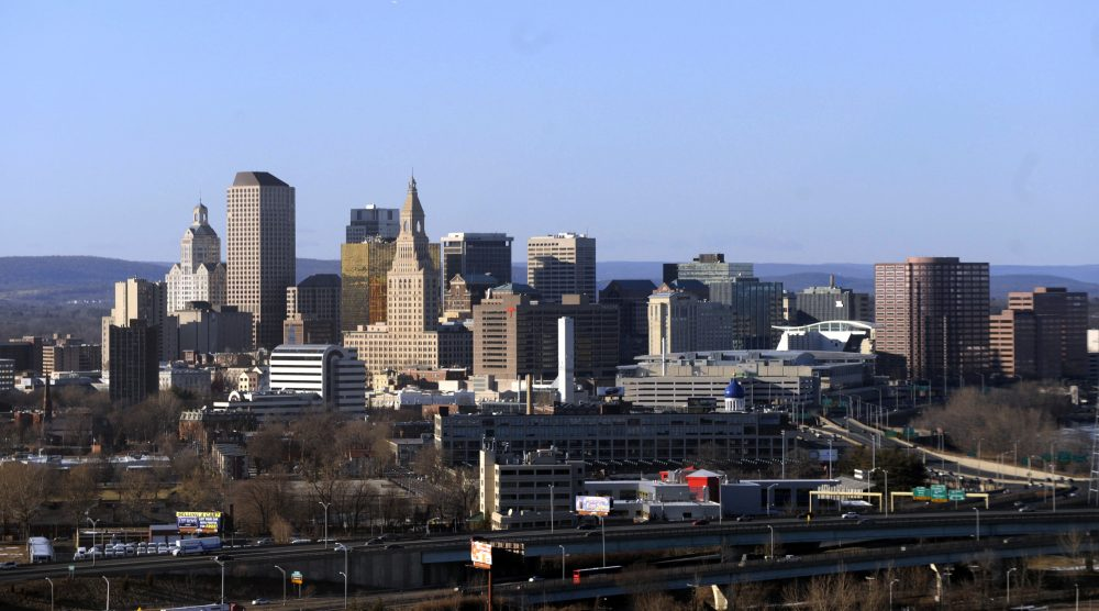 In this Feb. 7, 2010 aerial file photo, the skyline of Hartford, Conn., rises on the west bank of the Connecticut River. The struggling capital city is trying to persuade lawmakers to provide $40 million more in 2017 from the state's cash-strapped coffers to help offset a projected $65 million deficit in 2018. (Jessica Hill/AP)