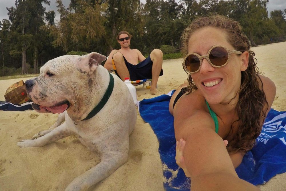 """Mary Finley, Travis Sherman and Tonka at the beach. """"I'm fearful of the world that we are making for ourselves,"""" Travis said. """"That's why I don't want to have children."""" (Courtesy Mary Finley)"""