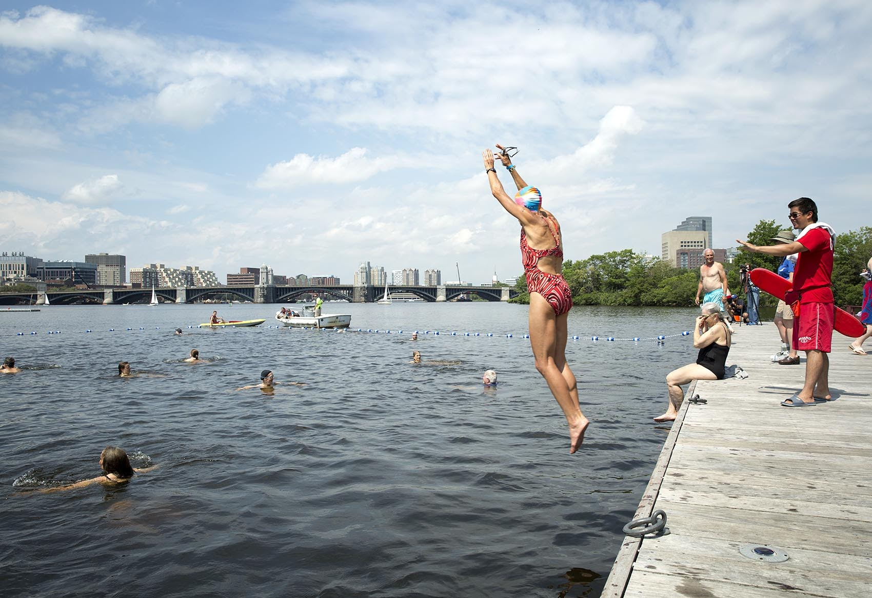 Swimmers jump into the Charles River at City Splash. (Robin Lubbock/WBUR)