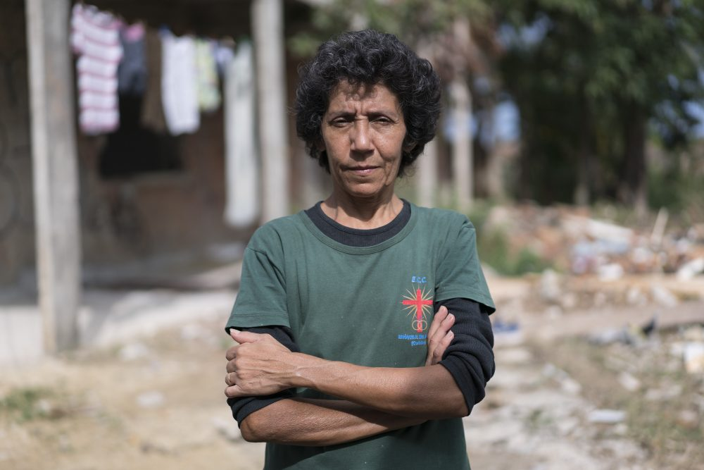 "In this June 3, 2016 photo, Maria da Penha, a resident of the Vila Autódromo favela located next to Olympic Park, poses for a portrait in Rio de Janeiro, Brazil. Penha's home in a favela abutting the Olympic Park, known at Vila Autodromo, was demolished to make way for new construction. ""For me the Olympics were awful,"" said the 51-year-old, who led a year-long eminent-domain battle against Rio Mayor Eduardo Paes. ""They destroyed my life, my dream. I had my own house and I won't have it anymore."" (Renata Brito/AP)"