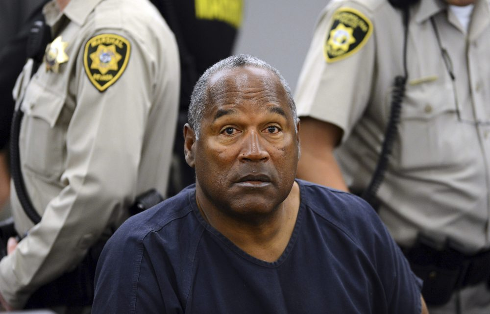 In this May 14, 2013 pool file photo, O.J. Simpson sits during a break on the second day of an evidentiary hearing in Clark County District Court in Las Vegas. Simpson, the former football star, TV pitchman and now Nevada prison inmate, will have a lot going for him when he appears before state parole board members Thursday, July 20, 2017 seeking his release after more than eight years for an ill-fated bid to retrieve sports memorabilia. (Ethan Miller, Pool/AP)