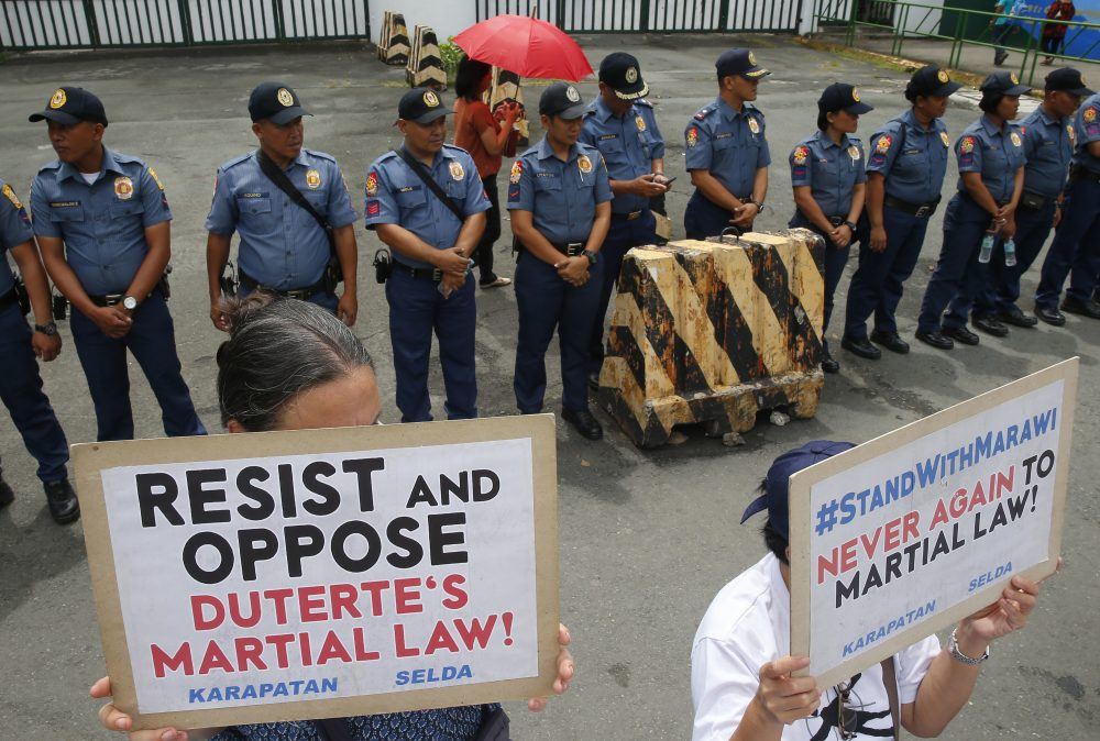 Protesters display placards during a rally outside Camp Aguinaldo, the general headquarters of the Armed Forces of the Philippines, to protest the extension of Martial Law in the whole of Mindanao island in the southern Philippines as proposed by President Rodrigo Duterte, Thursday, July 20, 2017 in Quezon city northeast of Manila, Philippines. (Bullit Marquez/AP)