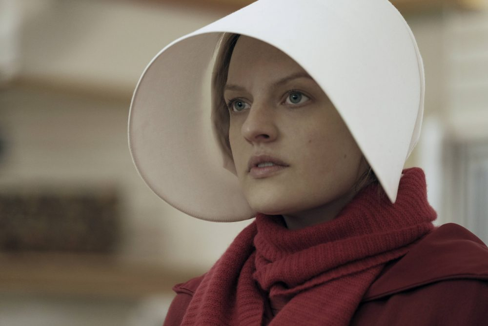 "This image released by Hulu shows Elisabeth Moss as Offred in a scene from, ""The Handmaid's Tale."" Moss was nominated for an Emmy Award for outstanding lead actress in a drama series on Thursday, July 13, 2017. (George Kraychyk/Hulu via AP)"