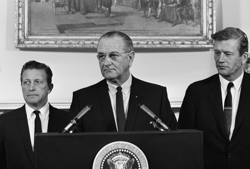 President Lyndon Johnson speaks to members of his advisory commission on civil disorders at the group's first meeting on July 29, 1967 at the White House, Washington. Otto Kerner, left, of Illinois, the chairman of the group and Mayor John Lindsay of New York (right) vice chairman. (AP Photo/WX)