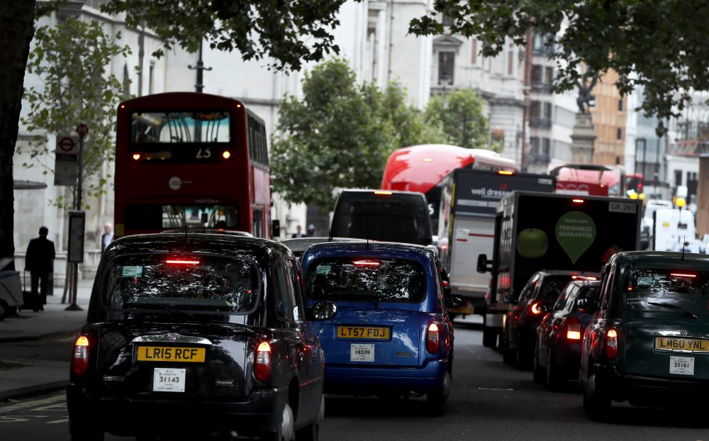 Vehicles drive in central London, Wednesday, July 26, 2017. Britain is pledging to ban the sale of new gas- and diesel-powered cars by 2040. (Kirsty Wigglesworth/AP)
