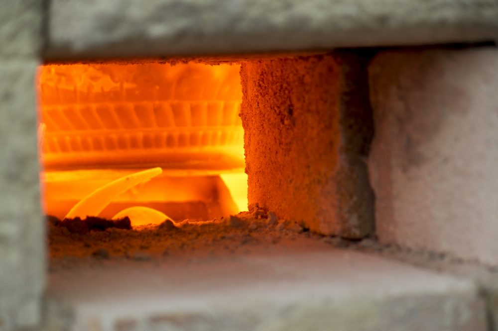 Livan's kiln has to reach 2,200 degrees before he'll load in his pottery to be fired. (Andrea Shea/WBUR)