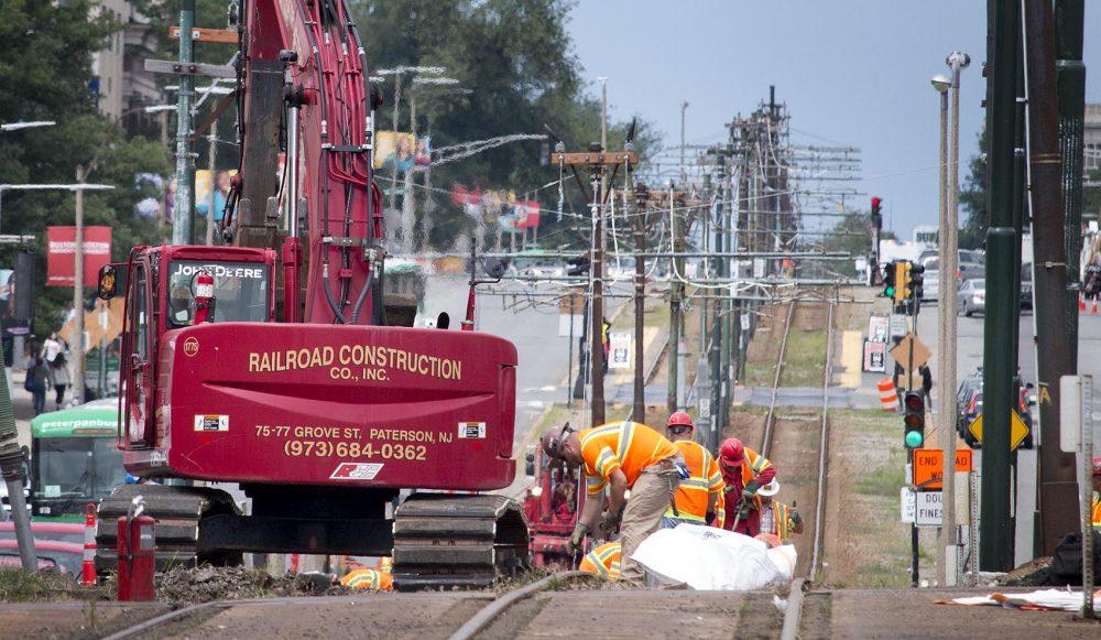 MBTA staff remove Green Line tracks on Commonwealth Ave. (Kathleen Dubos for WBUR)