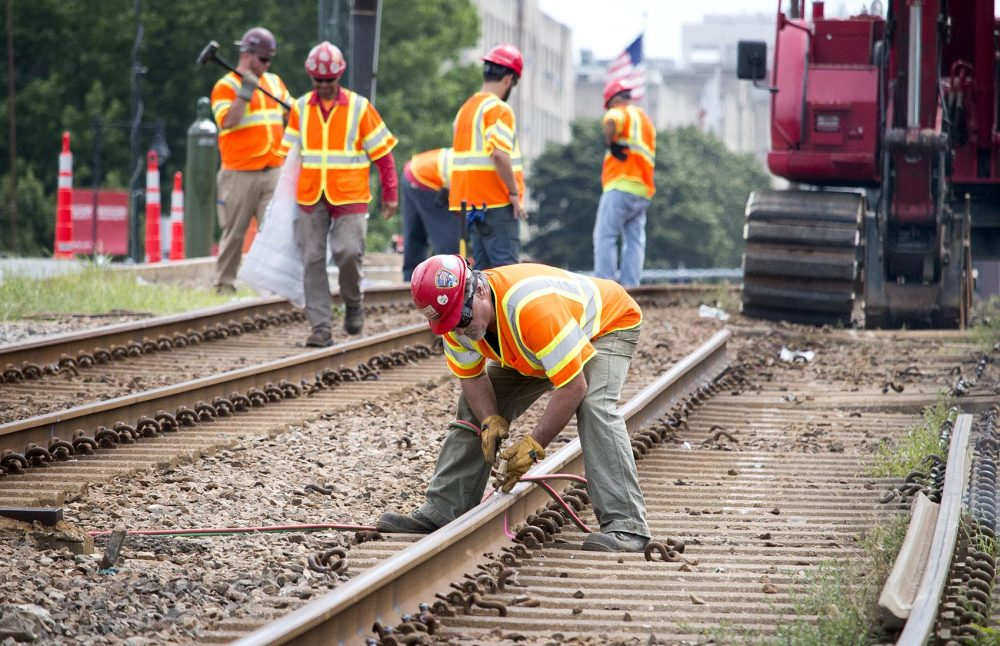 MBTA staff remove tracks along Commonwealth Ave. (Kathleen Dubos for WBUR)