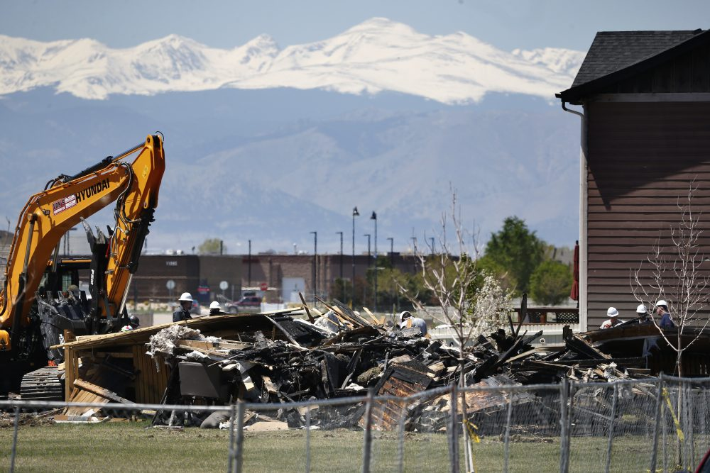 Workers dismantle the charred remains of a house at the location where an unrefined petroleum industry gas line leak explosion killed two people inside their home, in Firestone, Colo., Thursday, May 4, 2017. (Brennan Linsley/AP)