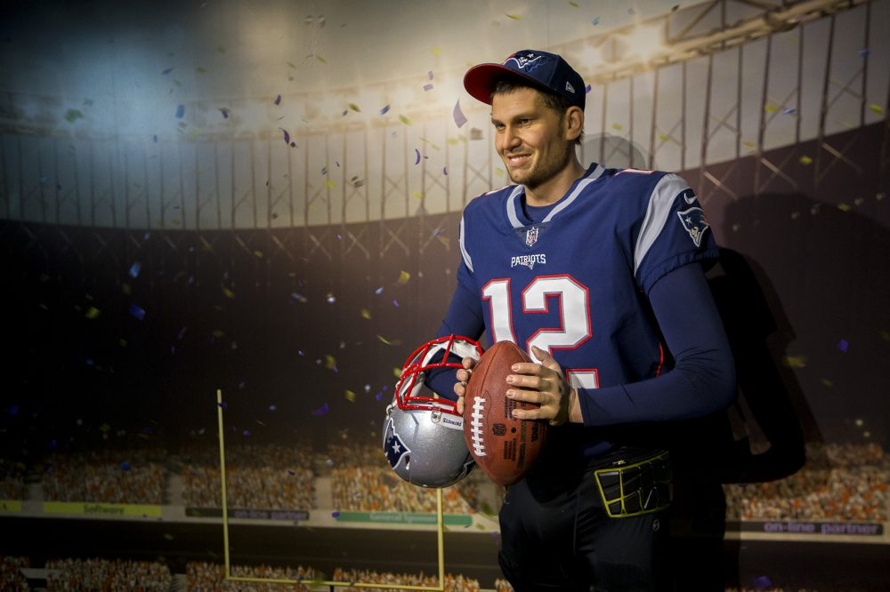 Patriots quarterback Tom Brady will have a cellphone charger nearby at the Dreamland Wax Museum. (Jesse Costa/WBUR)