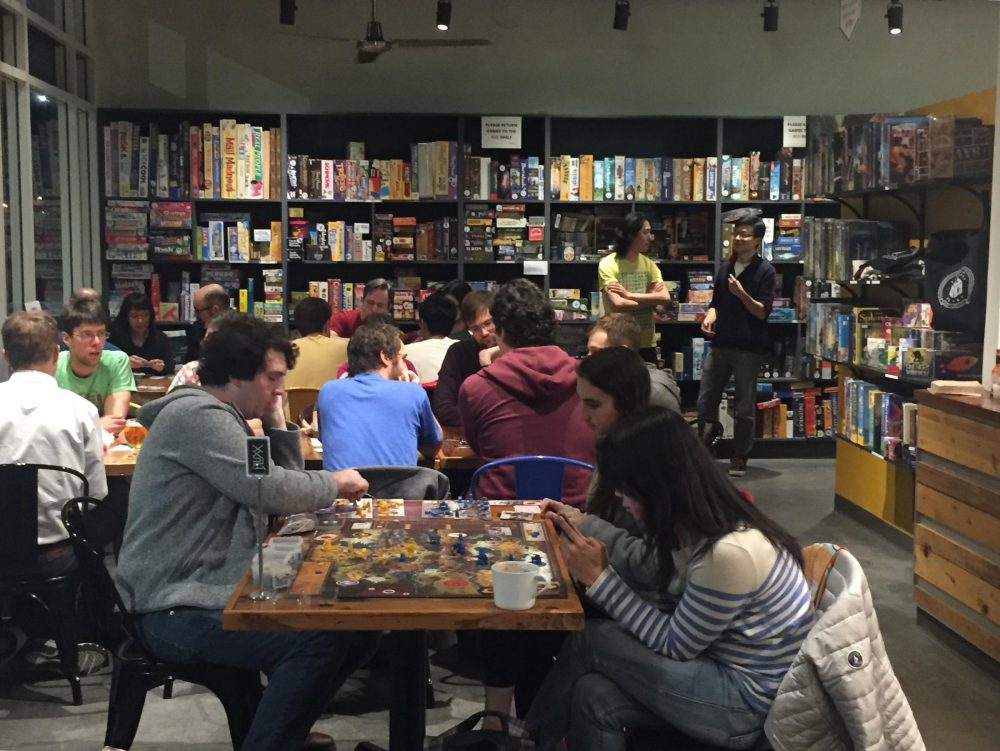 """At a recent """"designer night"""" at Victory Point Cafe, local game designers and cafe customers """"play test"""" several game ideas designers are trying to improve upon. (Sonia Paul)"""