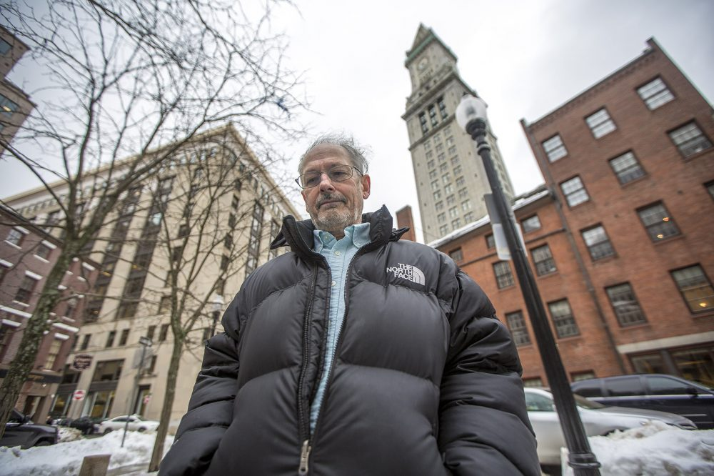 Historian Dane Morrison stands in front of Boston's Custom House, where in the 1800s goods from China that had been hauled off ships were weighed on giant scales. (Jesse Costa/WBUR)