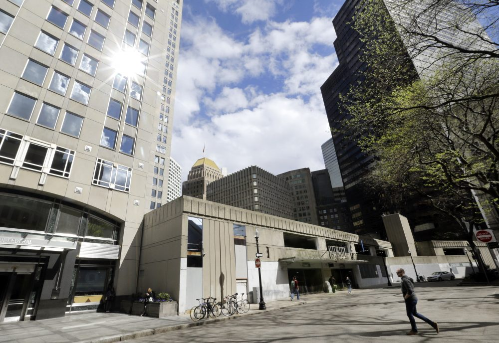 A man walks by the now-closed Winthrop Square Garage in Boston, the site of a proposed $1 billion, 775-foot skyscraper.  (AP Photo/Elise Amendola)