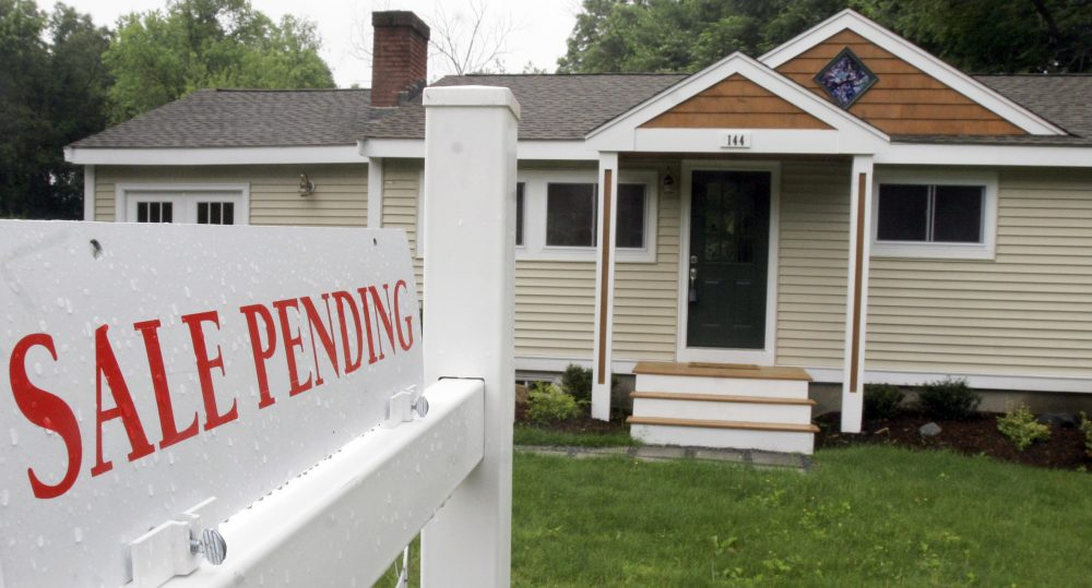 A sign announces a residential home sale is pending in Framingham. (Bill Sikes/AP File)