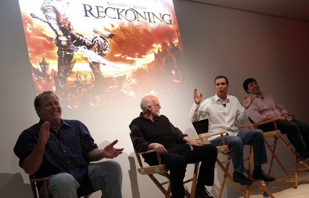 """Curt Schilling and other creators behind """"Kingdoms of Amalur: Reckoning,"""" the only game produced by 38 Studios, participate in a panel discussion in 2011. (Jason DeCrow/AP Images for Electronic Arts)"""