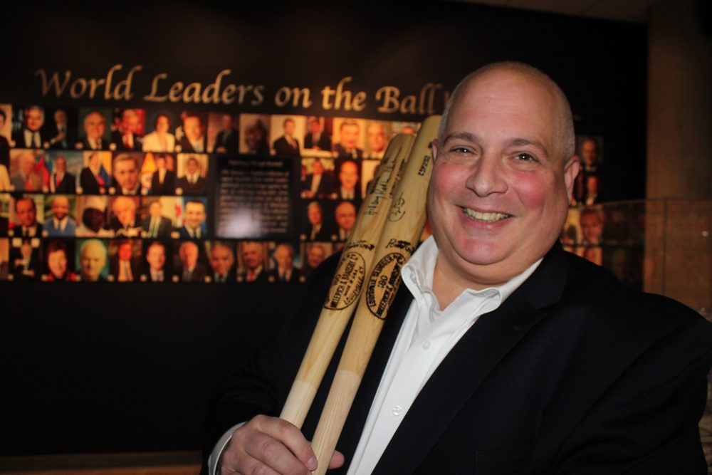 Randy Kaplan spends 20 to 30 hours a week researching world leaders and prospective world leaders. Here he holds autographed baseball bats signed by former President Barack Obama and Hillary Clinton. (Frank Eltman/AP)