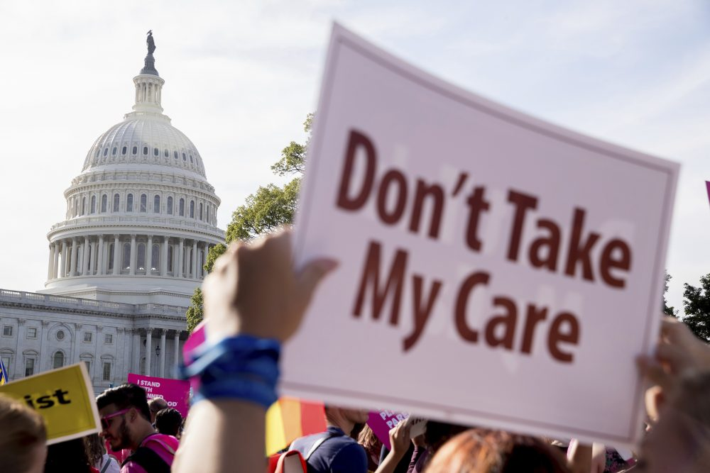 A large group of protesters rally against the Senate Republican health care bill in front of the Capitol Building in Washington Wednesday. (Andrew Harnik/AP)