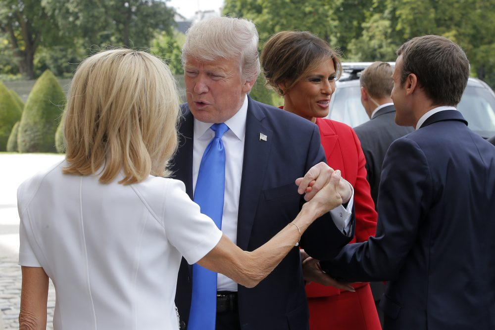 French President Emmanuel Macron, right, welcome First Lady Melania Trump while and his wife Brigitte, left, welcomes U.S President Donald Trump at Les Invalides museum in Paris Thursday, July 13, 2017. President Donald Trump and French President Emmanuel Macron planned to meet Thursday in Paris to focus on issue where they can take U.S.-French relations forward, security and defense issues chief among them. (Michel Euler/AP)