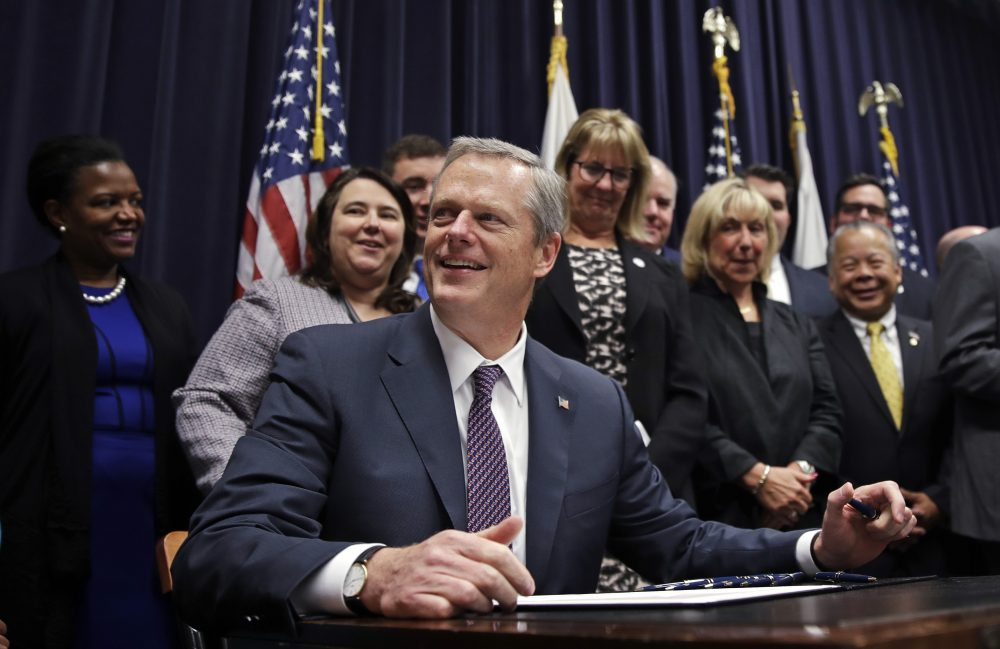 Gov. Charlie Baker pauses as he signs into law the Pregnant Workers Fairness Act during a ceremony at the State House Thursday, July 27, 2017. (Charles Krupa/AP)