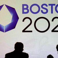 In this Jan. 21, 2015, file photo, organizers and reporters wait for a news conference by organizers of Boston's campaign for the 2024 Summer Olympics in Boston. To great fanfare, the U.S. Olympic Committee chose Boston as its bid city for the 2024 games, only to see local support collapse in spectacular fashion within months amid spirited opposition from opponents resisting any use of taxpayer money to help defray the costs. (Charles Krupa/ AP)