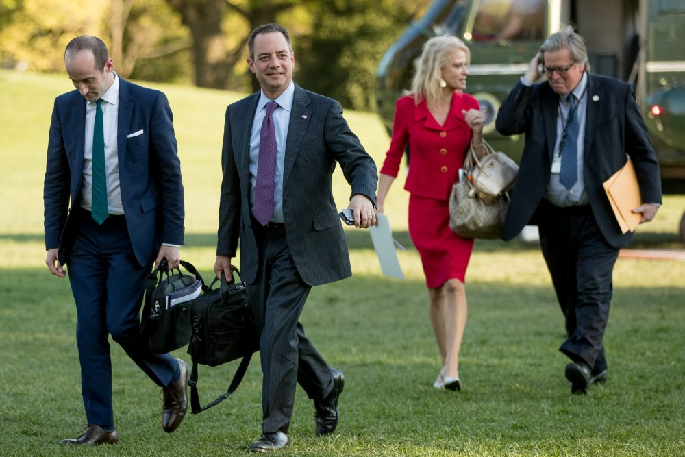 From left, President Donald Trump's White House Senior Adviser Stephen Miller, President Donald Trump's Chief of Staff Reince Priebus, Counselor to the President Kellyanne Conway, and President Donald Trump's White House Senior Adviser Steve Bannon, walk across the South Lawn after President Donald Trump arrives at the White House in Washington, Tuesday, April 18, 2017. (Andrew Harnik/AP)