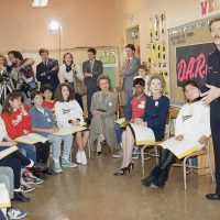 First Lady Nancy Reagan sits with students at Rosewood Elementary School in Los Angeles in February 1987 as they listen to a DARE presentation by a Los Angeles police officer. (Nick Ut/AP)