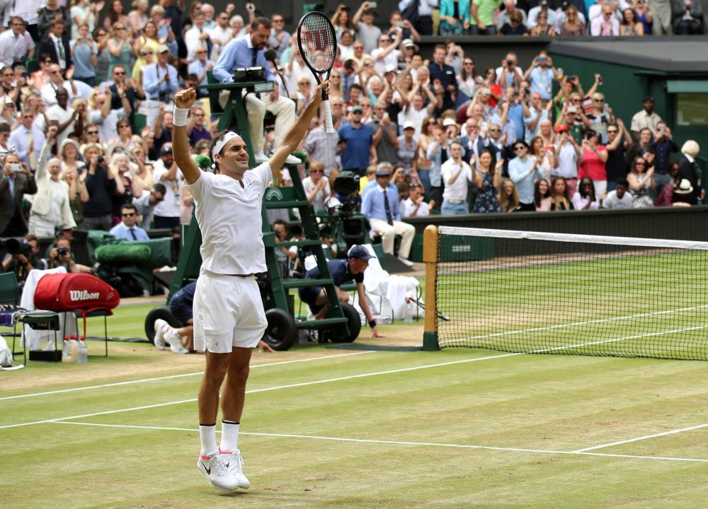 Roger Federer jumps for joy after winning his 8th Men's Singles title at Wimbledon. (Julian Finney/Getty Images)