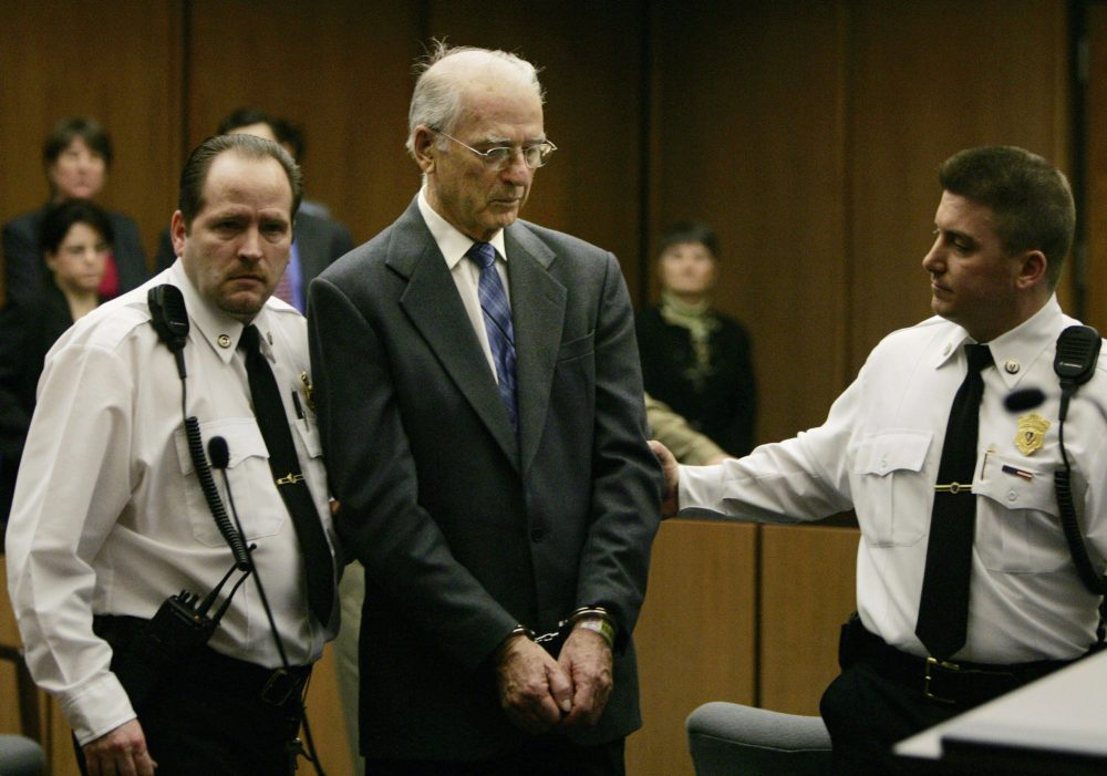 Defrocked priest Paul Shanley is led from Middlesex Superior Court in Cambridge, Mass. in handcuffs on Feb. 15, 2005, following his sentence of 12 to 15 years in prison for raping a boy repeatedly in the 1980s. (Charles Krupa/AP)