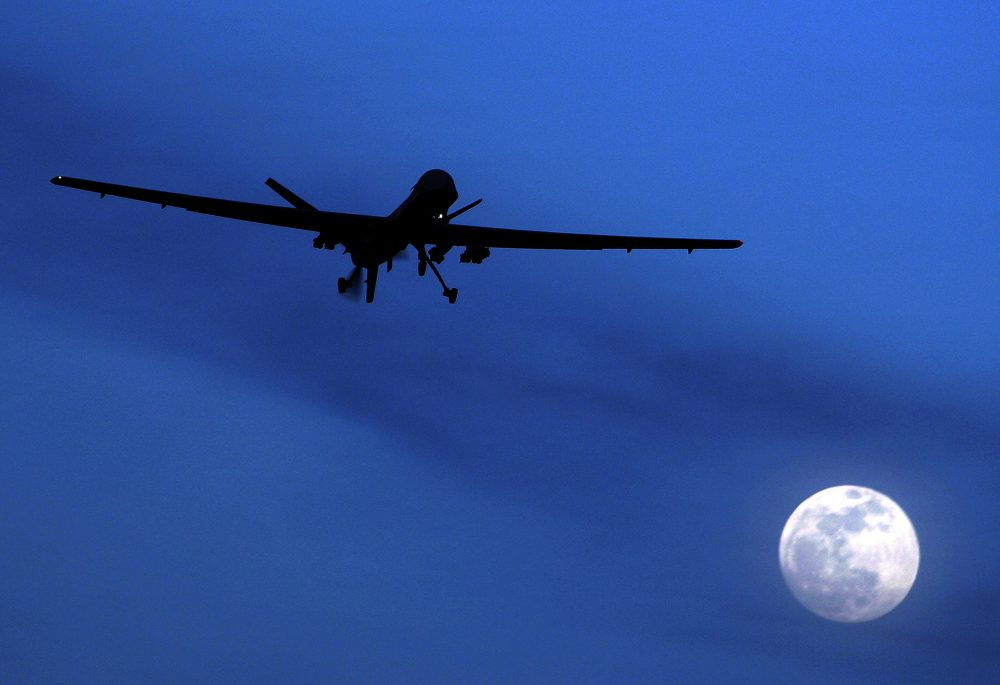 Drones are a permanent part of our arsenal, writes Rich Barlow, and that's a good thing. Pictured: An unmanned U.S. Predator drone flies over Kandahar Air Field, southern Afghanistan in 2010. (Kirsty Wigglesworth/AP)