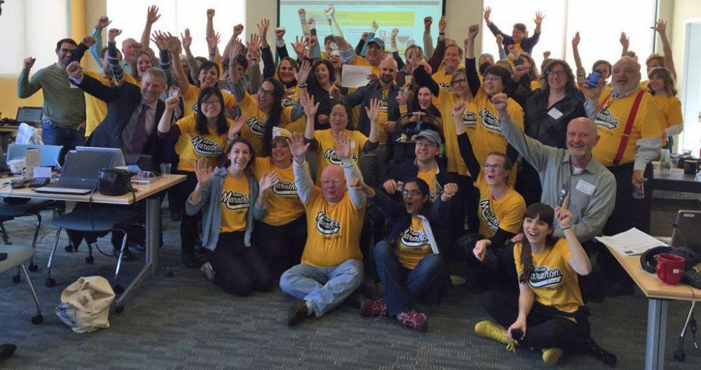 WBUR volunteers and staff celebrate reaching our $1 million marathon goal.
