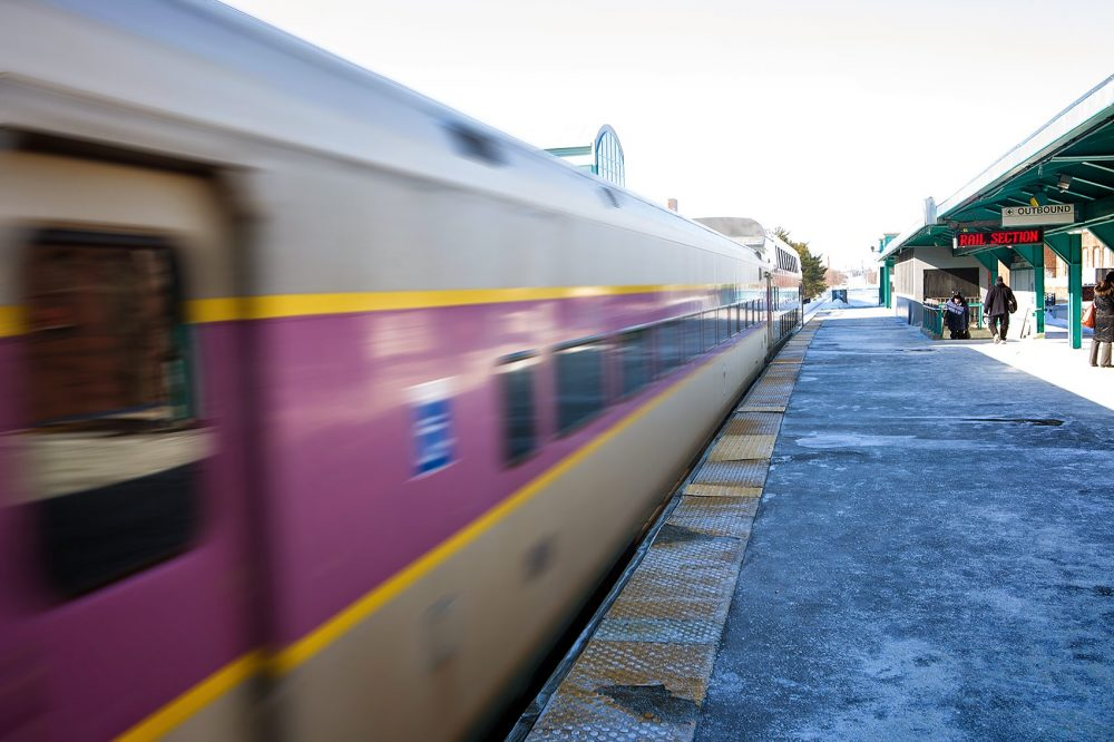 A commuter rail train speeds by. (Jesse Costa/WBUR)