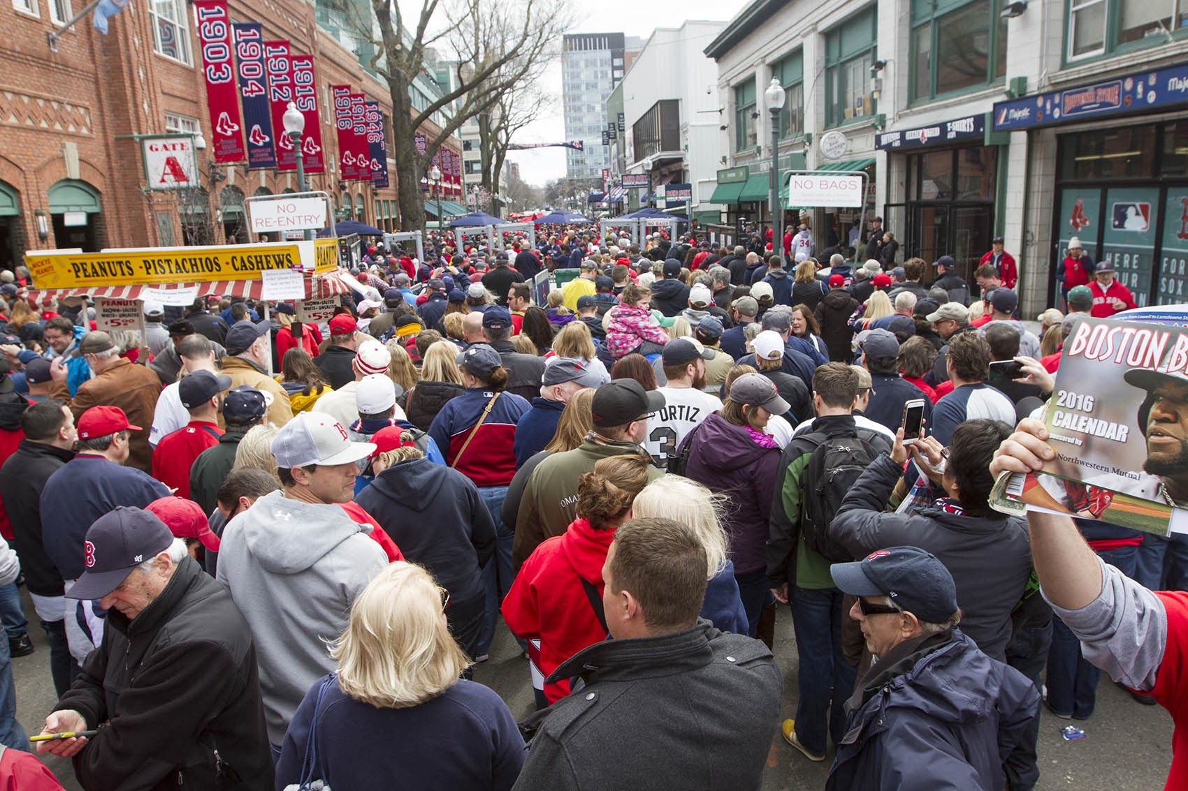 Fans wait in security lines on Yawkey Way to get into Fenway Park on Red Sox 2016 Opening Day. (Joe Difazio for WBUR)
