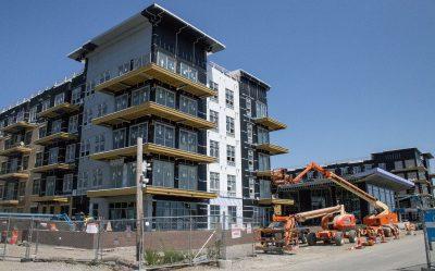 A new housing development being built on Lewis Street along the Boston Harbor. (Kathleen Dubos for WBUR)
