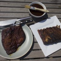 Kathy's slow-smoked Texas-style brisket (left), dry-rubbed pork ribs and best barbecue sauce. (Jackson Mitchell/Here & Now)