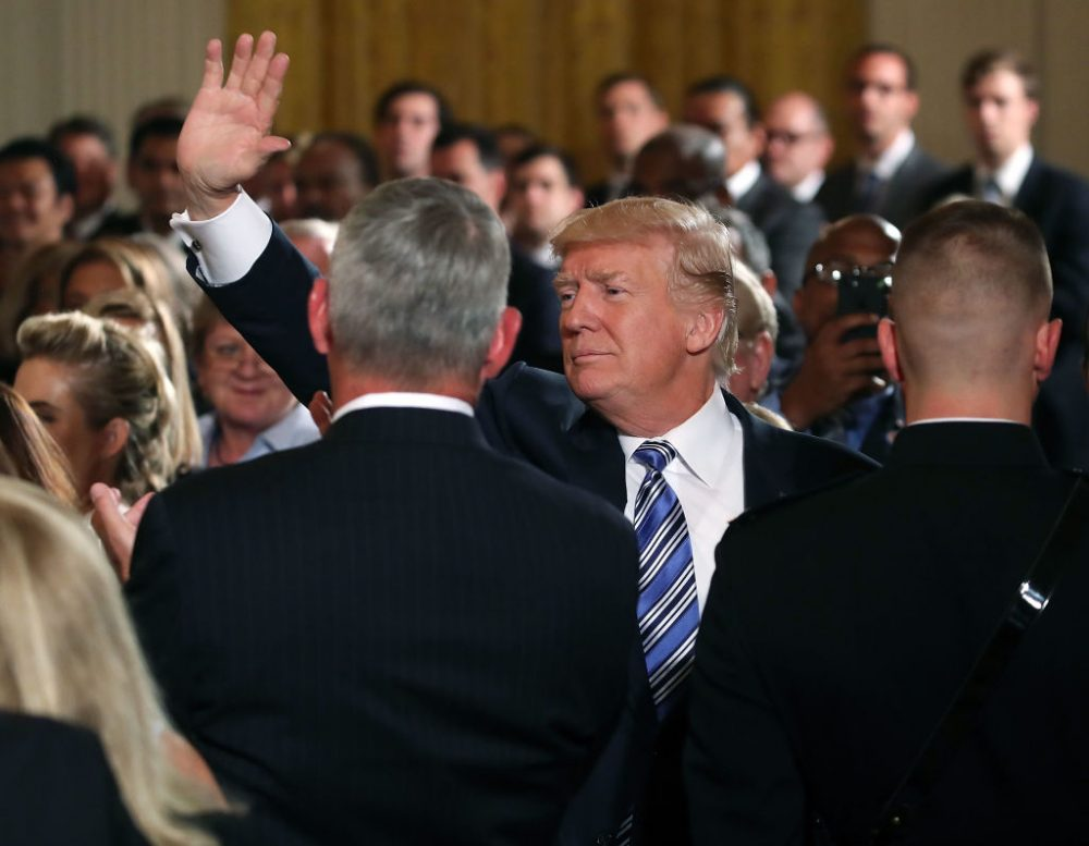 U.S. President Donald Trump waves to the crowd while attending a small businesses event in the East Room at the White House on Aug. 1, 2017 in Washington. (Mark Wilson/Getty Images)