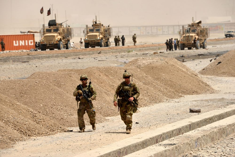 U.S. soldiers walk at the site of a Taliban suicide attack in Kandahar on Aug. 2, 2017. A Taliban suicide bomber on Aug. 2 rammed a vehicle filled with explosives into a convoy of foreign forces in Afghanistan's restive southern province of Kandahar, causing casualties, officials said. (Javed Tanveer/AFP/Getty Images)