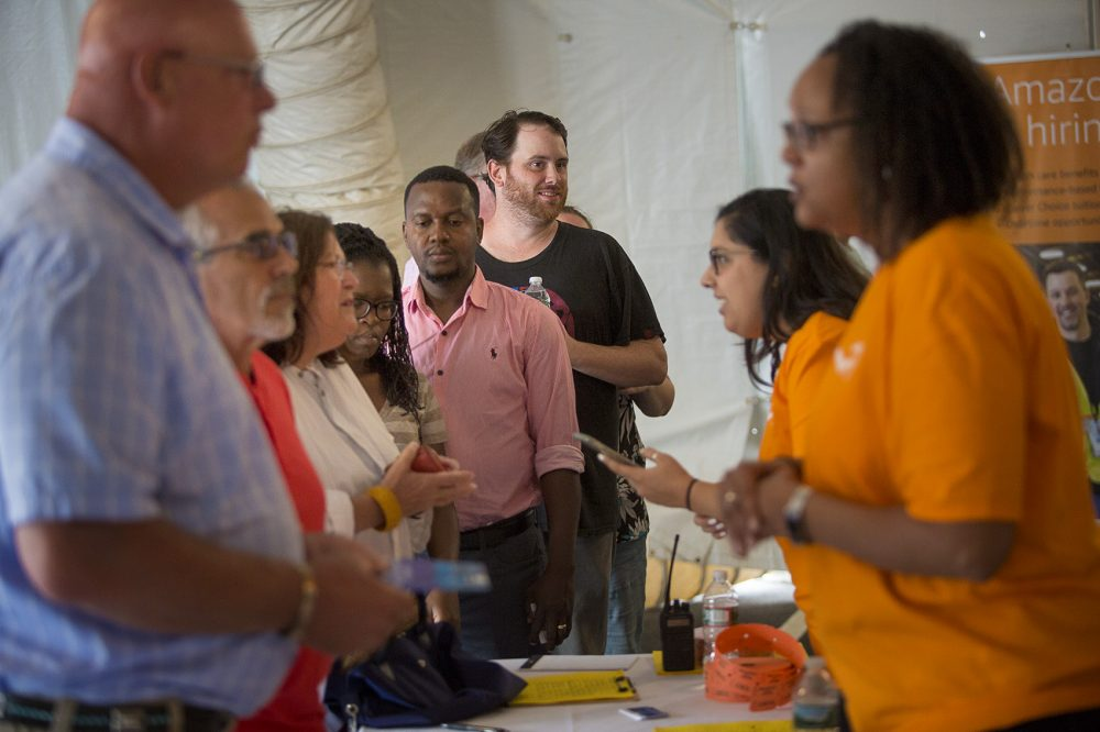 People line up to sign up for tours of Amazon's Fall River warehouse during a job fair Tuesday. (Jesse Costa/WBUR)