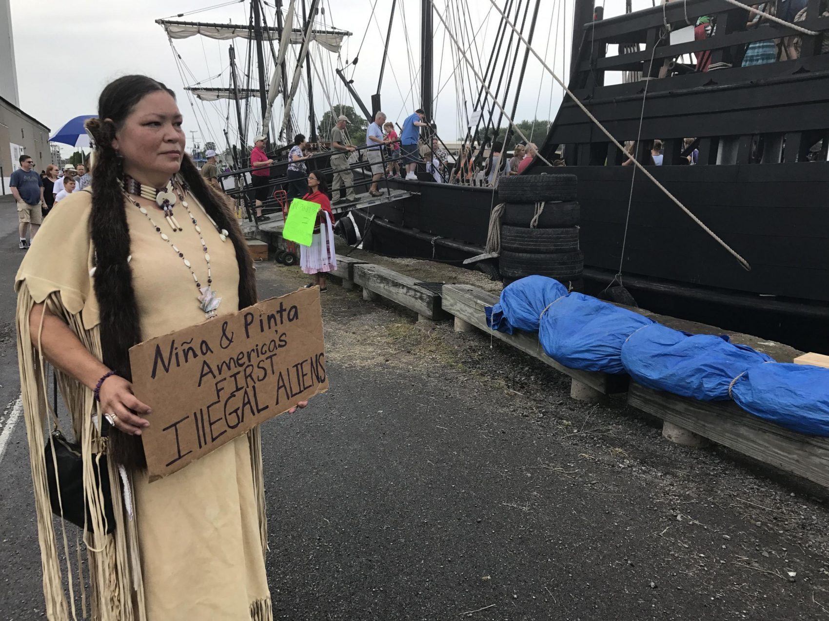 Renee Roman Ose, a descendent of the Oklahoma Cheyenne, came to the Oswego Harbor Saturday to protest the two Christopher Columbus ships and educate people on about the genocide and terror it brought to the original inhabitants of the Americas. (Payne Horning/WRVO)