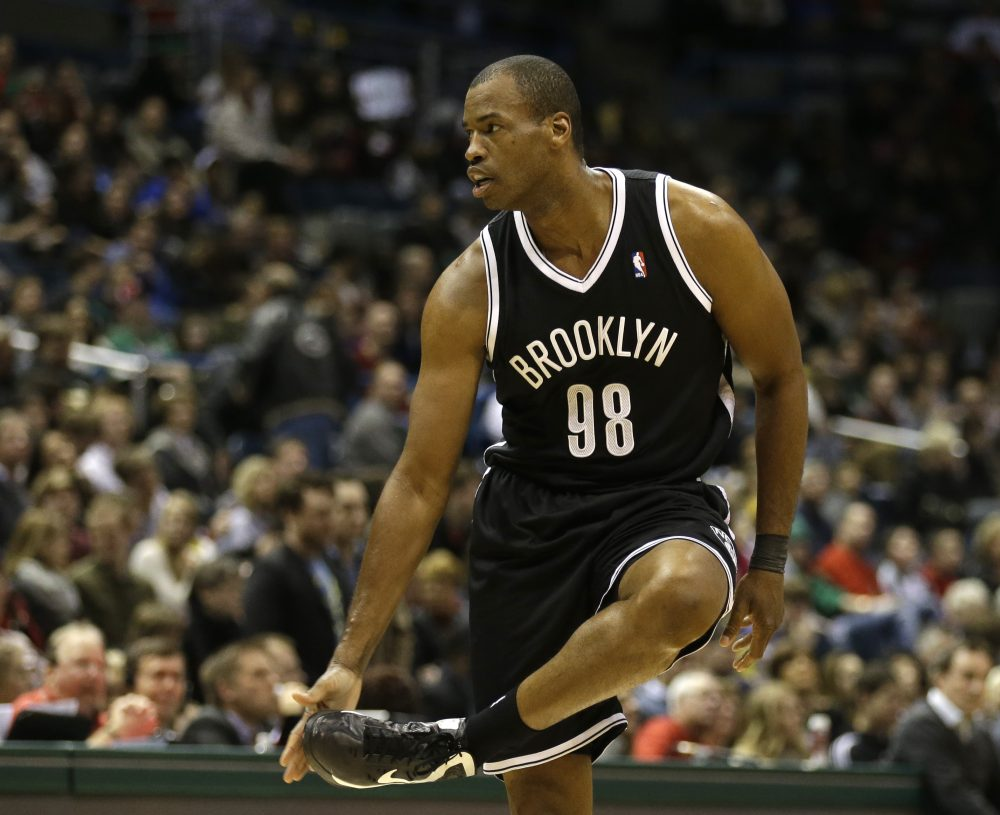 """During the NBA lockout of 2011, everything started to change for Jason Collins. """"I was sitting on my couch with my dog, watching TV and thinking, 'Is this going to be it for the rest of my life?'""""(Jeffrey Phelps/AP)"""
